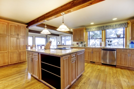 home appliances: Large wood kitchen with hardwood and wood beam. Stock Photo