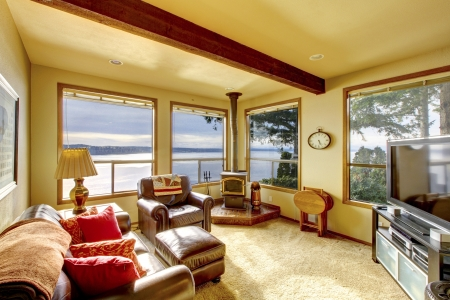 family  room: Small cozy living room with TV and water view.