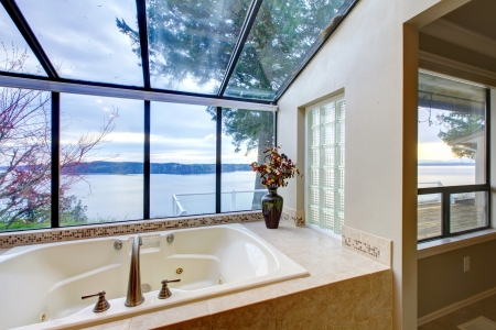 Large tub with beige tiles and glass wall of windows. Stock Photo - 14287706