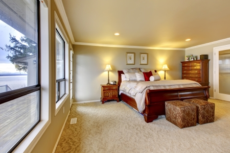 clean carpet: Large bedroom with water view. Stock Photo