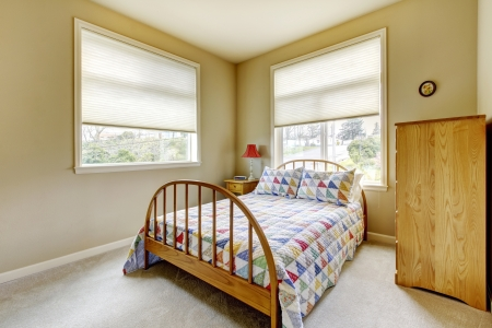 Simple bedroom with two large windows and wood bed. Stock Photo - 14287712