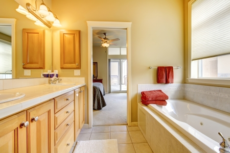 Bathroom with wood cabinets, tile floor and tub. Stock Photo - 14287619