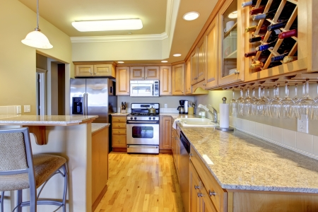 Beautiful wood golden kitchen in golden colors. photo