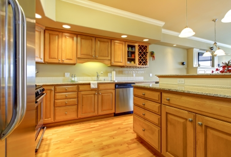 stainless steel kitchen: Luxury apartment wood kitchen interior.