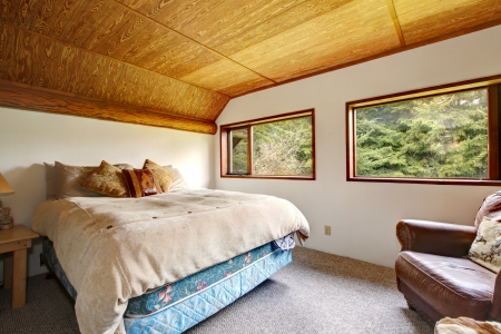 Cowboy bedroom interior with wood ceiling. Stock Photo - 14295743