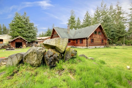 Classic American old log cabin in the country side.