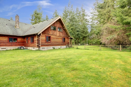 Spring landscape and rustic old log cabin. photo