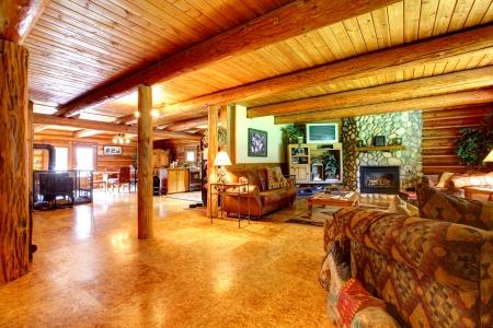 wood ceiling: American cowboy log cabin living room interior.