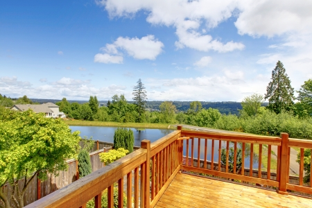 balcony: Beautiful wood balcony deck with view of the lake. Stock Photo