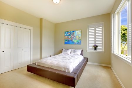 Bright bedroom with modern brown bed and art Stock Photo - 14287616