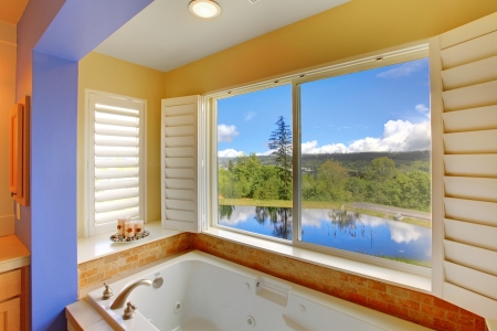 Beautiful modern colorful tub with lake view. photo