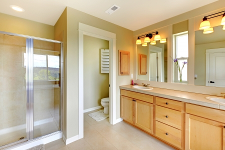 bathroom sink: Large classic beautiful bathroom with double sink and shower.