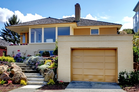 garage: House exterior with large garage and staircase.