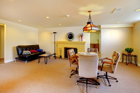 Large basement living room with carpet and fireplace. Stock Photo - 14287709