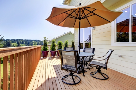 deck: Deck with unbrella, chairs and table. Stock Photo