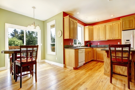Yellow kitchen with wood and red and green colors with island. Stock Photo - 14615037
