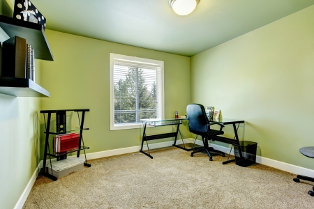 copy room: Home office with beige carpet and simple furniture. Stock Photo