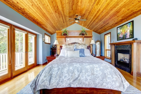 idea comfortable: Blue bedroom with wood ceiling and fireplace interior.