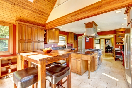 Red large luxury kitchen interior with beautiful wood and tile floor. photo