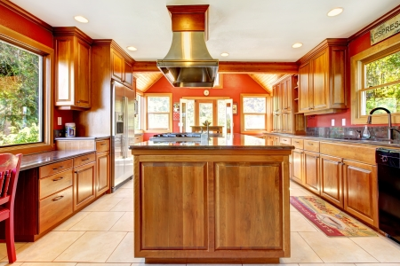 kitchen cabinets: Large red luxury kitchen interior with wood and tiles. Stock Photo
