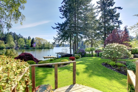 Spring landscape woth lake on the backyard and deck. Stock Photo - 14615306