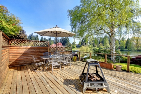 fire pit: Beautiful spring deck with umbrella and fire pit.