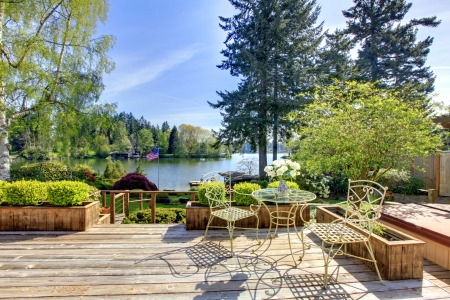 Large deck with chairs and water lake view in the spring sunny day. Stock Photo - 14615308