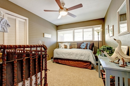 nursery room: Classic brown and blue bedroom interior. Stock Photo