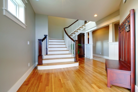Luxury home beautiful hallway with large grand staircase and hardwood floor. photo