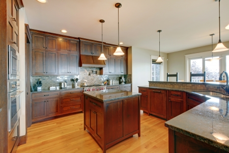 cabinets: Luxury pine wood beautiful custom kitchen interior design with island and granite. Stock Photo