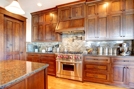 Luxury pine wood beautiful custom kitchen interior design with island and granite. Stock Photo