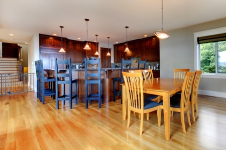 Luxury home kitchen and dining room with open floor plan and rich wood. Stock Photo - 14874103