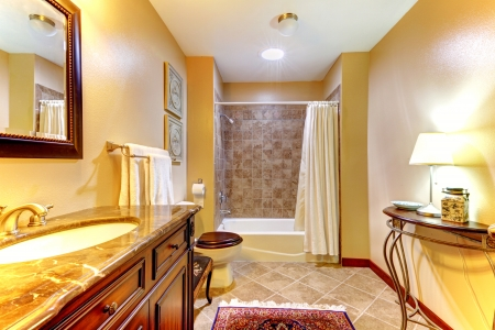 interior spaces: Golden nice bathroom with brown  ceramic tiles and wood cabinet.