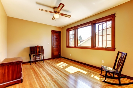 trim wall: Empty room with yellow walls and hardwood floor in the nice old house.