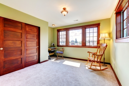 trim wall: Nice empty bedroom with two windoows and wood closet doors and green walls. Stock Photo