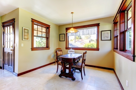 dining room: Nice dining room with wood walls and hardwood floor in an old house.