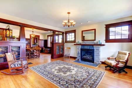Beautiful old craftsman style home living room interior with fireplace. photo