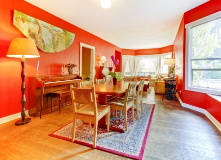 Red dining room with piano, hardwood floor and many windows Stock Photo - 15783844