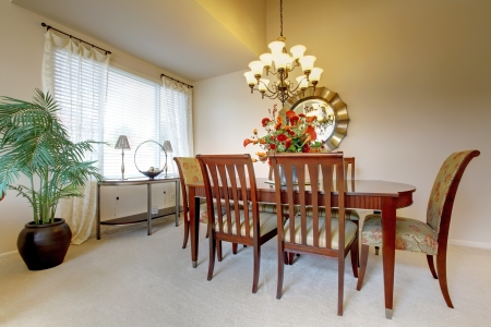 Golden dining room with elegant classic furniture. photo