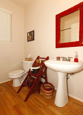 Small bathroom with sink and toilet and hardwood floor. Stock Photo - 15783850