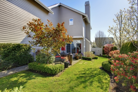 Nicely landscaped back yard with house during spring in NorthWest USA. photo