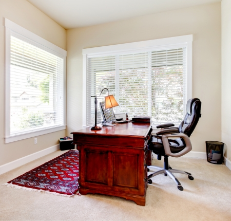 Home classic office with mahogany desk and letaher chair. photo