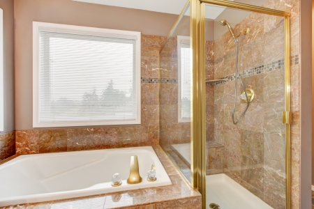 luxuries: Luxury new granite shower and tub with gold metal. Stock Photo