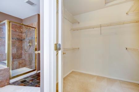 walk in closet: Large walk in closet and granite shower in the bathroom.