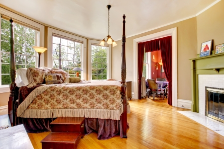 Large historical Inn room interior - bedroom with antique post bed. Stock Photo - 15961210