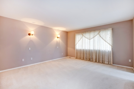 Large beige bedroom interior with lights and curtains. photo