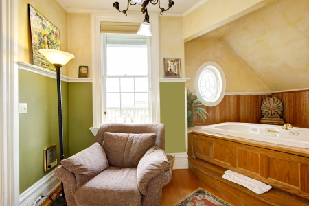 Historical Inn room interior - bathroom with tub and armchair with window. Stock Photo - 15960577