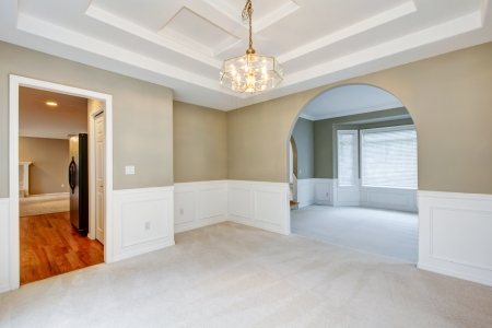 Empty luxury home interior with beige carpet of dining and living room. photo