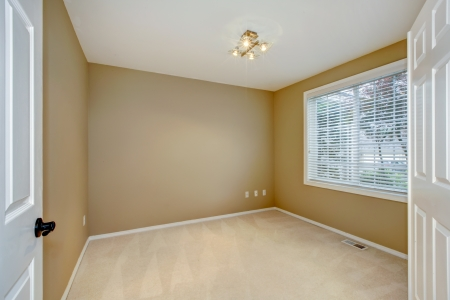 large doors: Empty new bedroom interior with brown and beige and open large white doors.