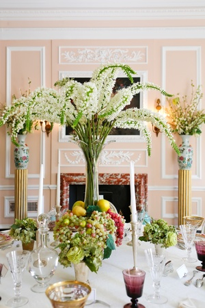 arrangment: Luxury diing room antique historical table arrangment with flowers and fruits  Stock Photo